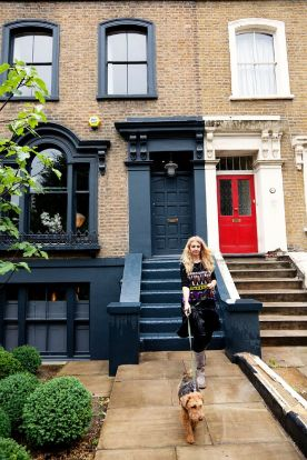 Abigail in front of her London townhouse