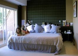 Cristina in the master bedroom